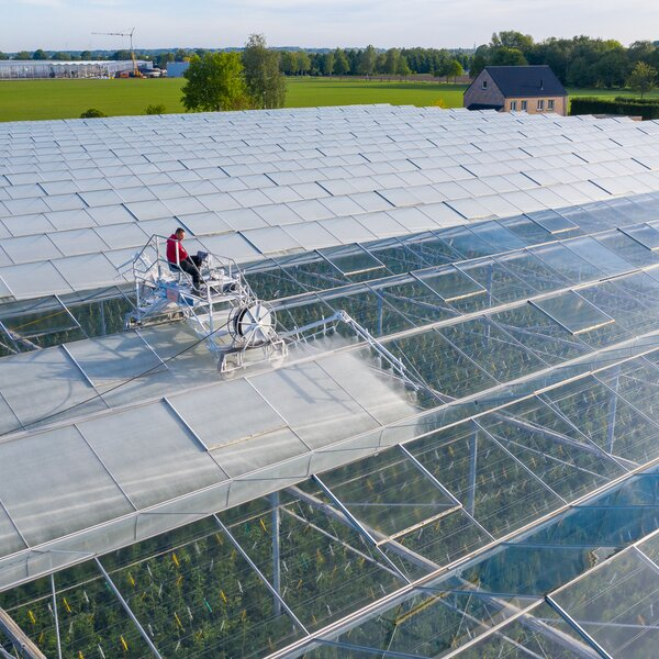 Machine application of ReduFuse IR on glass greenhouse